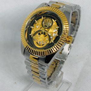 Montre Rolex   Gris et Or cadran Or et Noir